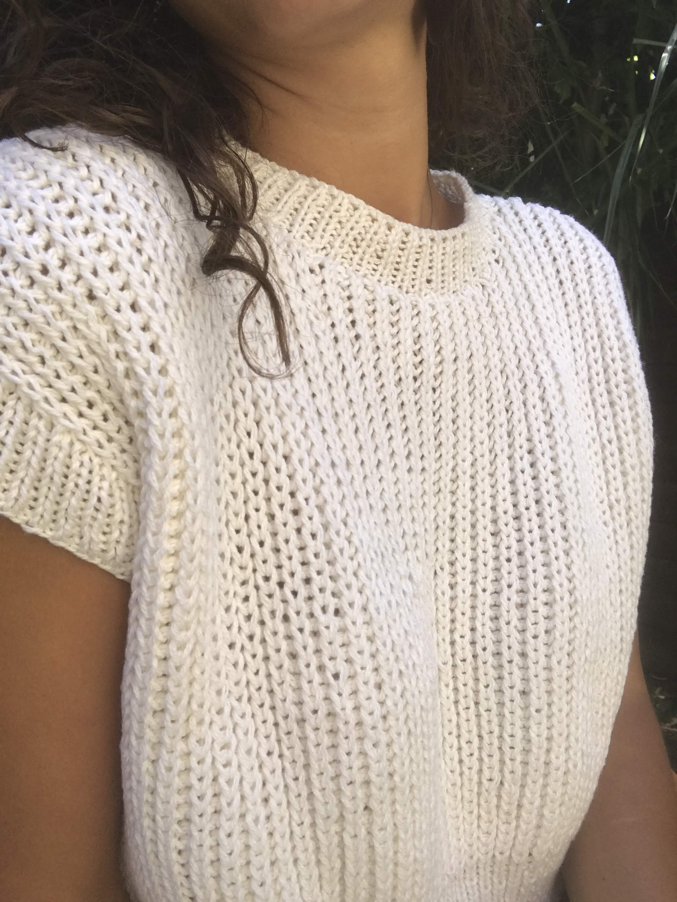 Close up of the jumper worn by Giorgia, but from the other side.It shows the neck detail and gives an idea of how much ease is involved.