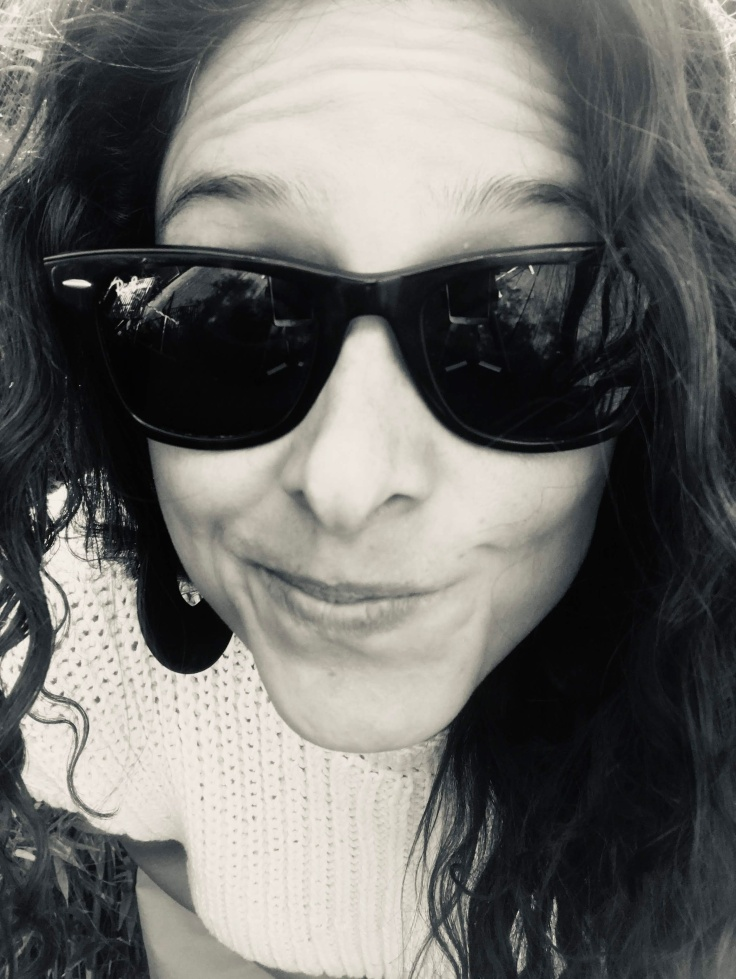Huge black and white close up go Giorgia wearing big sunglasses and another silly face - for good measure! God forbid people start taking this seriously.